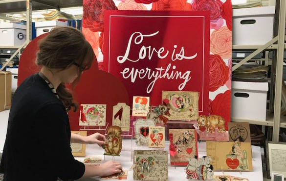 Bradbeer prepares a Valentine's Day display for the nearby Hallmark Visitors Center. Hallmark has created millions of products since 1910, and the Hallmark Archives has stored and preserved a sampling from every year and holiday or occasion (Courtesy of Hallmark Cards, Inc.).