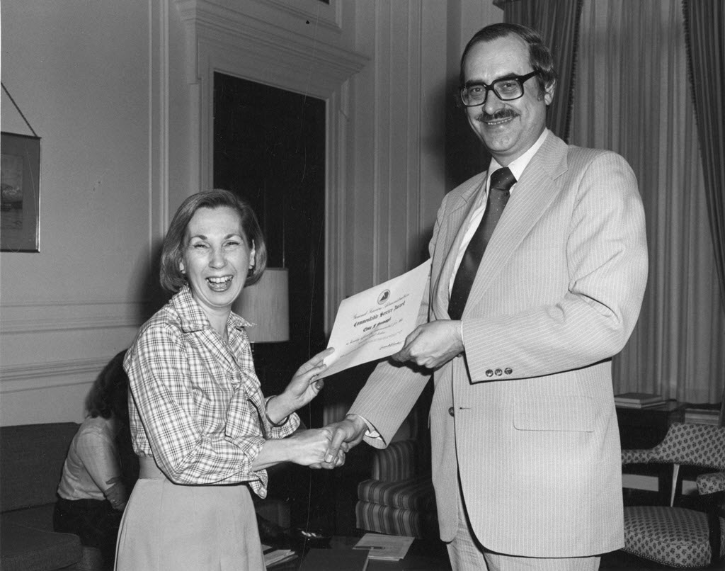 "Elsie Freeman Finch receiving an award from Archivist of the United States Bert Rhoads, May 12, 1977.  Join us at SAA AHS in DC August 16 at 4:15 to learn more during our panel: ""Guide to Navigation in Perilous Times: Journeys through Archival History and Historiography"" (Photo courtesy of Alex Poole, from the National Archives of the United States)"