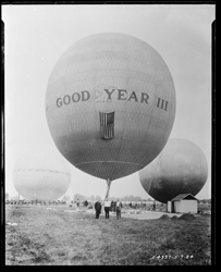"A4337_24 ""Goodyear III Balloon"" The Goodyear III balloon in a field with three men posing in front.  1924-05-07"